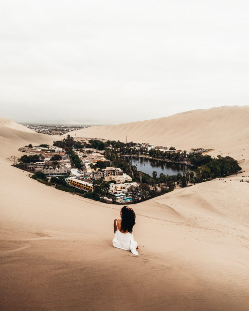huacachina peru oasis girl view