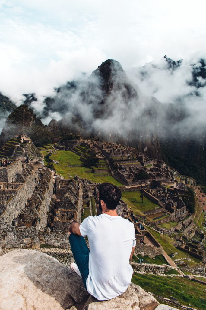 man in front of machu picchu peru